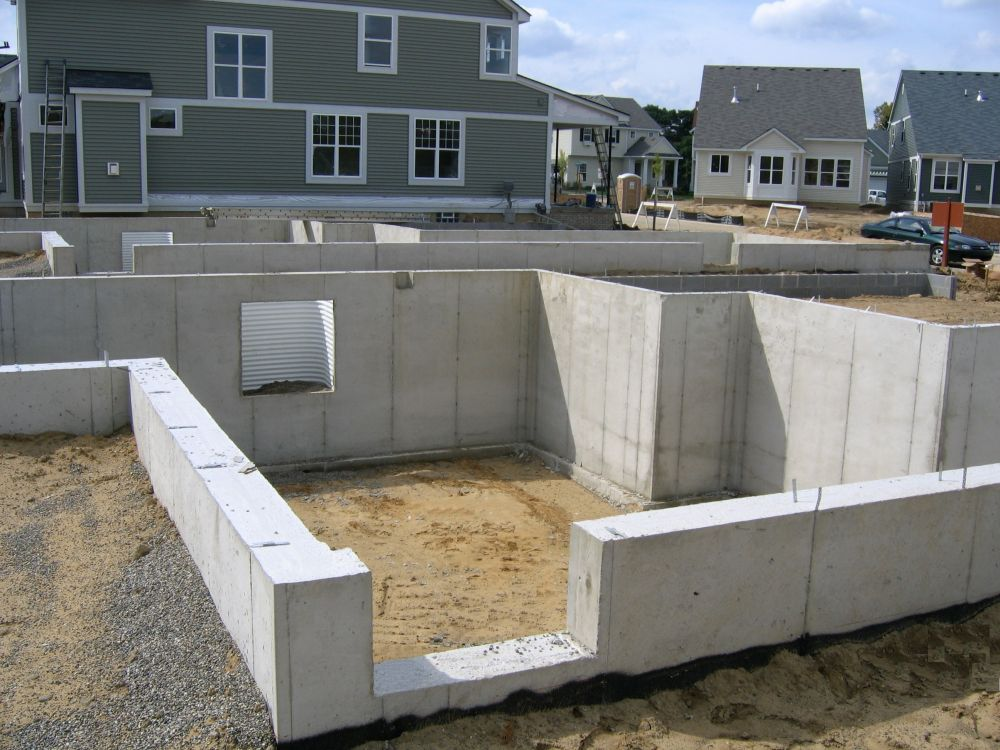 Fenton poured walls inc call now ph for Basement foundation construction